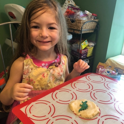 Olivia making fossil cookies!