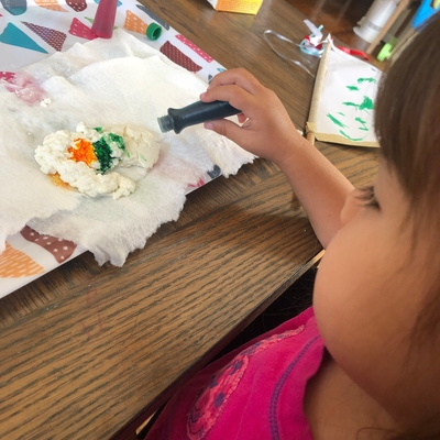 Olivia adding colors to our moldable milk