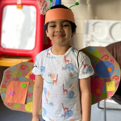 Ahaan, with his butterfly wings and antenna hat.
