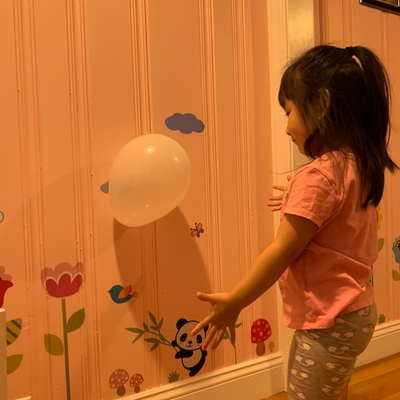 Averie got her balloon to stick on the wall!