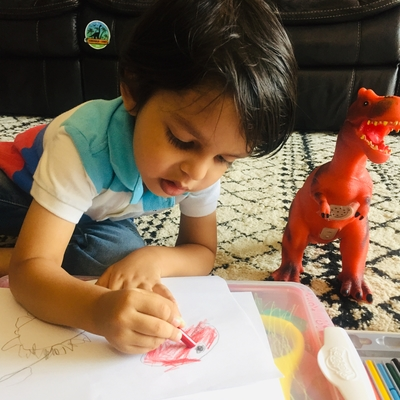 Reyansh making Trex drawing with the story